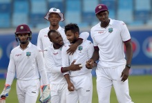 West Indies spinner Devendra Bishoo (2R) celebrates with his teammates after taking the wicket of Pakistani batsman Asad Shafiq on the fourth day of the first day-night Test between Pakistan and the West Indies at the Dubai International Cricket Stadium in the Gulf Emirate on October 16, 2016. / AFP / AAMIR QURESHI        (Photo credit should read AAMIR QURESHI/AFP/Getty Images)