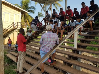 Inniss interacts with villagers